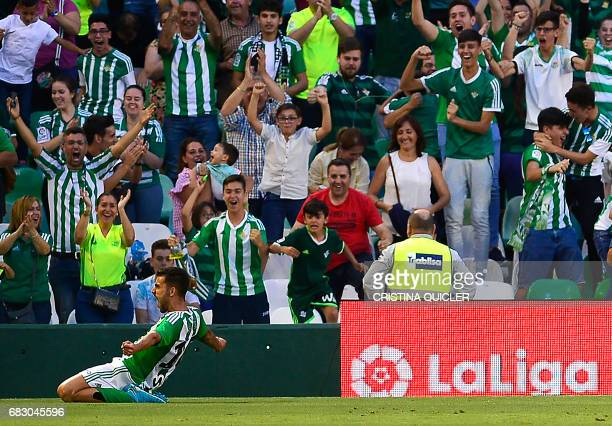 Betis' forward Dani Ceballos celebrates after scoring a goal during the Spanish league football match Real Betis vs Club Atletico de Madrid at the...