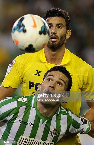 Betis' forward Jorge Molina vies with Villarreal's Argentinian defender Mateo Musacchio during the Spanish league football match Real Betis vs...