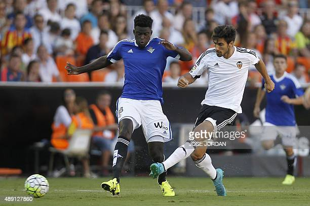 Betis' French Senegalese defender Alfred N'Diaye vies with Valencia's Portuguese midfielder Andre Gomes during the Spanish league football match...