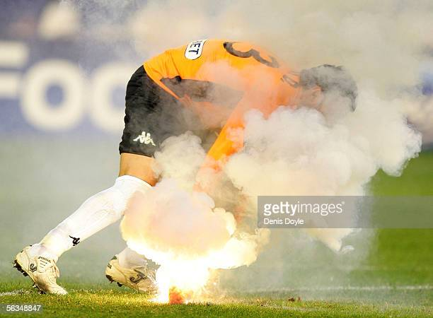 Betis goalkeeper Antonio Doublas removes a flare from the field during the UEFA Champions League Group G match between Real Betis and Anderlecht on...