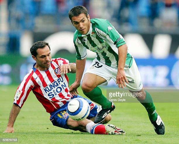 Betis` Israel gets past a fallen Sergi Barjuan of Atletico during a La Liga match between Atletico Madrid and Betis at the Calderon on May 15 2005 in...