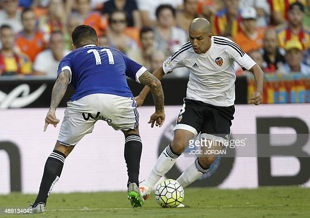Betis' Peruvian forward Jose Manuel Vargas vies with Valencia's French midfielder Sofiane Feghouli during the Spanish league football match Valencia...