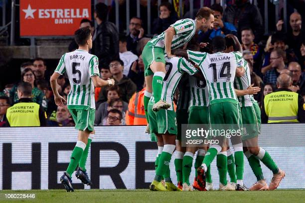 Betis players celebrate a goal during the Spanish league football match between FC Barcelona and Real Betis at the Camp Nou stadium in Barcelona on...