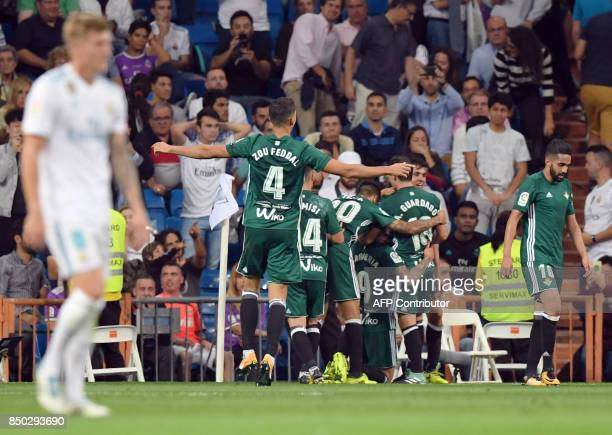 Betis players celebrate a goal during the Spanish league football match Real Madrid CF against Real Betis at the Santiago Bernabeu stadium in Madrid...