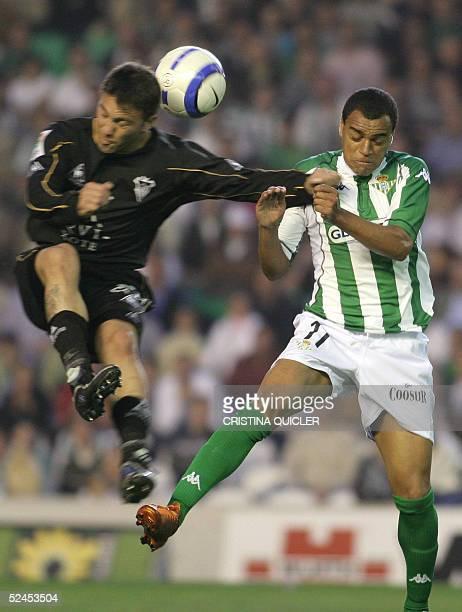 Betis's Brazilian Denilson de Oliveira vies with Albacete's Peralta during the Spanish League football match in Ruiz de Lopera's stadium in Seville...