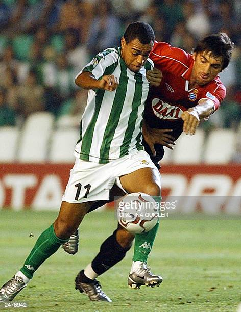 Betis's Brazilian player Denilson fights for the ball with Espanyol's German player Tayfun Korkut during a Spanish league match at the Ruiz de...
