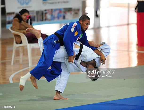 Betkil Shukvani from Georgia attacks Santos from Brazil, during a fight at semifinal of under 60 Kg Male category as part of the Judo World Cup 2012...