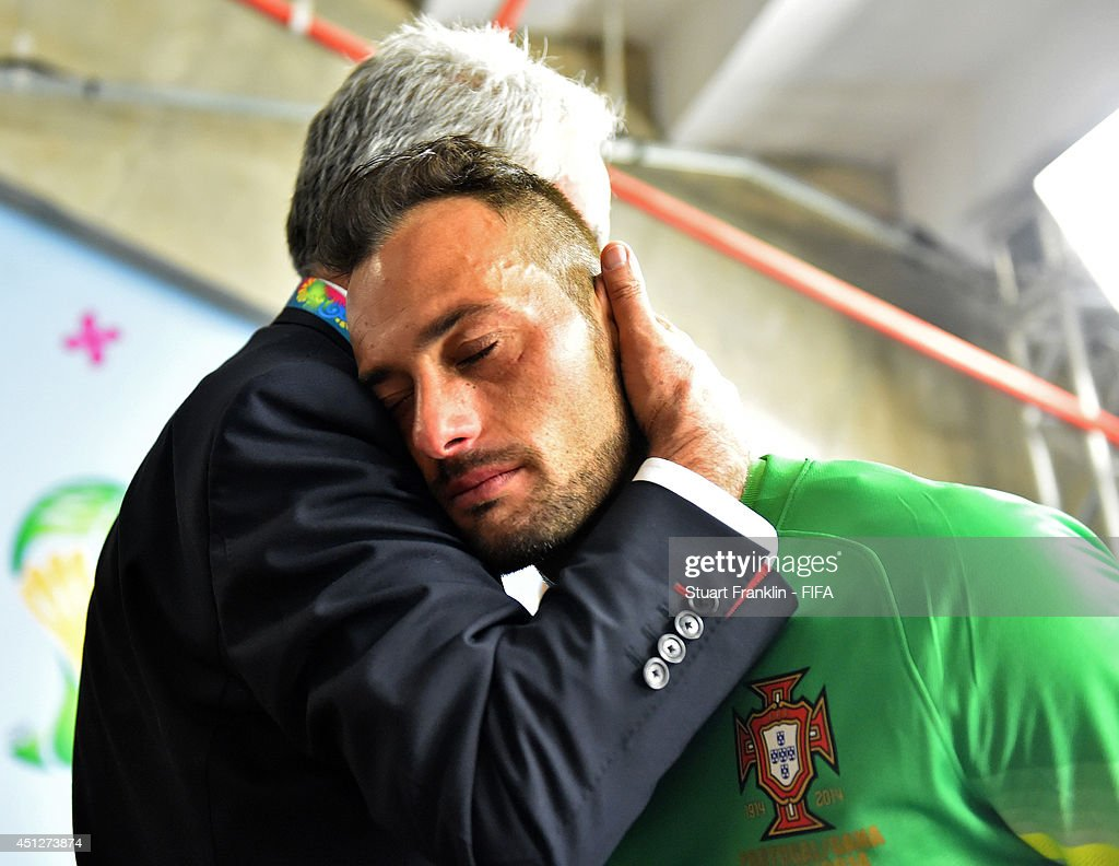 Beto of Portugal is consoled after the 2014 FIFA World Cup Brazil Group G match between Portugal and Ghana at Estadio Nacional on June 26, 2014 in Brasilia, Brazil.