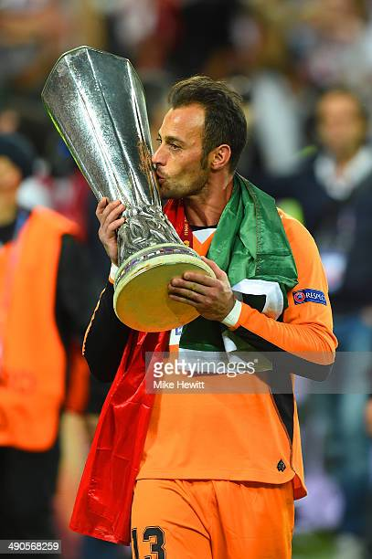 Beto of Sevilla kisses the Europa League trophy during the UEFA Europa League Final match between Sevilla FC and SL Benfica at Juventus Stadium on...