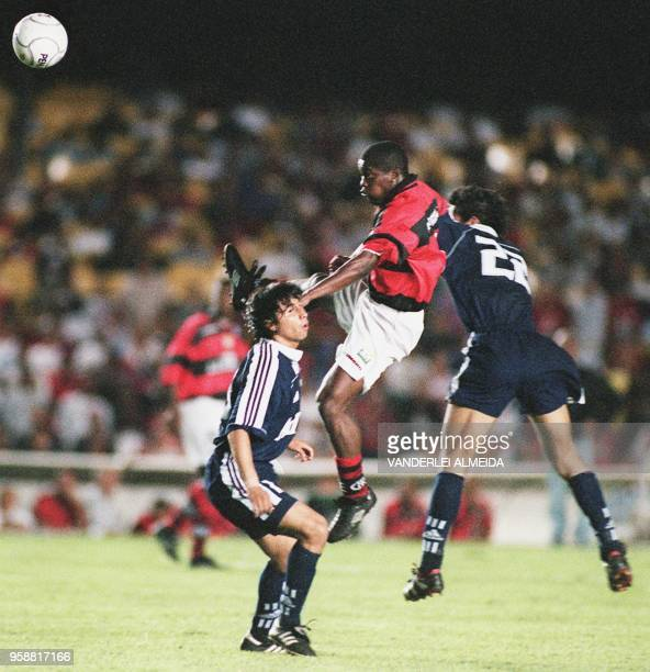 Beto of the Flamengo team fights for the ball with players Galdenes and Gonzalez in an attempt to win the Mercusor cup Rio de Janeiro Brazil 07...