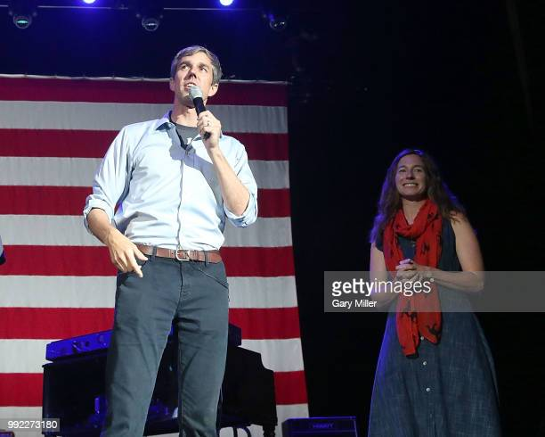 Beto O'Rourke and his wife Amy Hoover Sanders speak on stage at Willie Nelson's 45th 4th Of July Picnic at the Austin360 Amphitheater on July 4 2018...