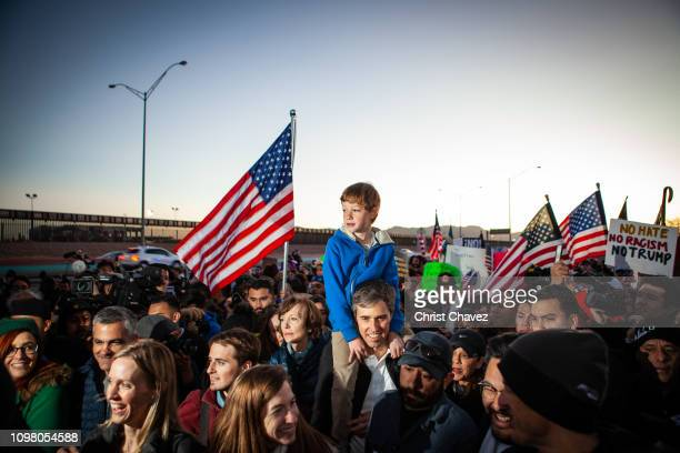 Beto O'Rourke carries his son Henry O'Rourke on his shoulder as they march along the US Mexico border in protest of President Donald Trump's proposed...