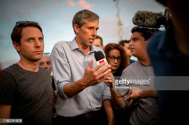 Beto O'Rourke, former Representative from Texas and 2020 Democratic presidential candidate, center, speaks to members of the media outside Cielo...