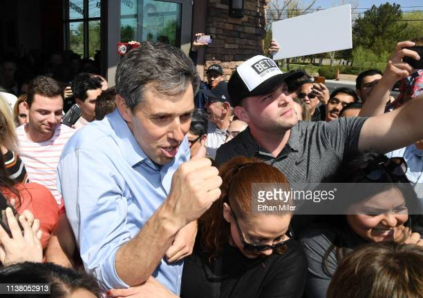 Beto O'Rourke is led through a group of supporters after holding a meetandgreet at Pour Coffeehouse on March 24 2019 in Las Vegas Nevada O'Rourke is...