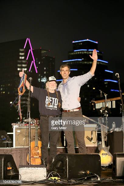Beto O'Rourke joins Willie Nelson on stage during the concert in support of Beto's campaign for US Senate at Auditorium Shores on September 29 2018...