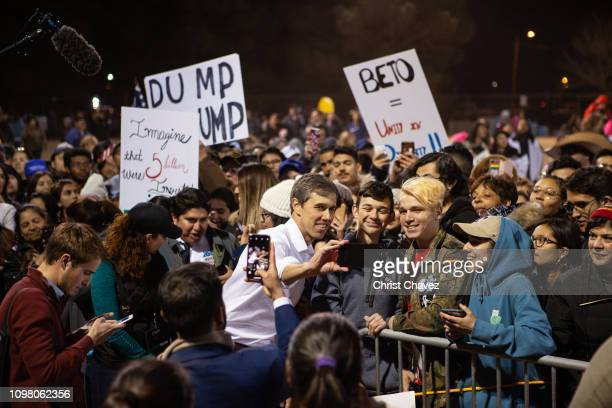 Beto O'Rourke takes selfies with supporters during a rally in protest of President Donald Trump's proposed border wall February 11 2019 in El Paso...