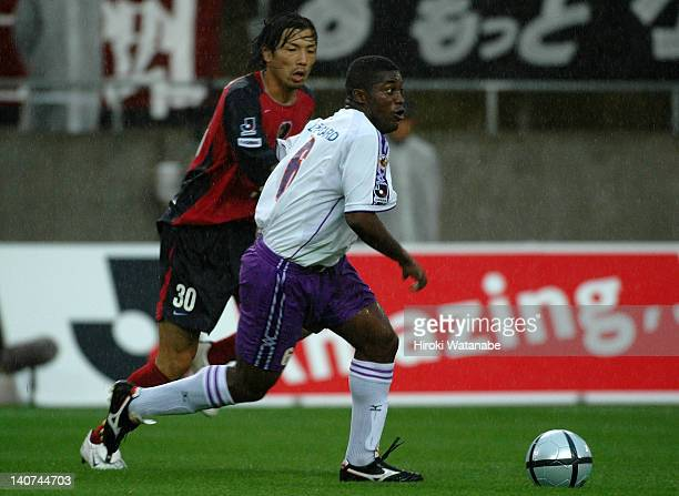 Beto, whose real name is Joubert Araujo Martins of Sanfrecce Hiroshima and Takayuki Suzuki of Kashima Antlers compete for the ball during the...