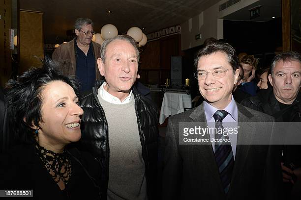 Betrand Delanoe posing with Michel Bessiere and Marie_Rose Guarnieri at the Prix Wepler 2013 Literary Prize award announcement on November 11 2013 in...