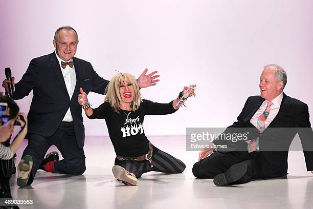 Betsey Johnson does the splits on the runway with the director's from Marist College at Betsey Johnson Reprise during MercedesBenz Fashion Week Fall...