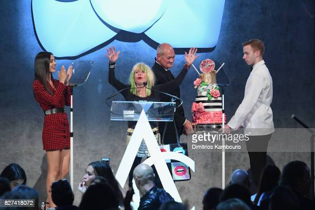 Betsey Johnson is presented a birthday cake onstage at the Accessories Council's 21st Annual celebration of the ACE awards at Cipriani 42nd Street on...