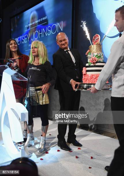 Betsey Johnson is presented with a birthday cake onstage at the Accessories Council's 21st Annual celebration of the ACE awards at Cipriani 42nd...
