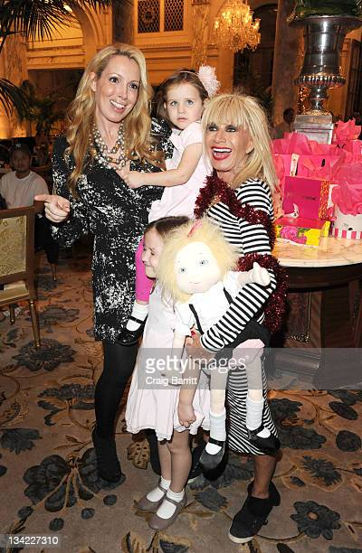 Betsey Johnson with daughter Lulu Johnson and grandaughters Ella Johnson and Layla Johnson attend the 2011 Eloise Christmas tree lighting at The...