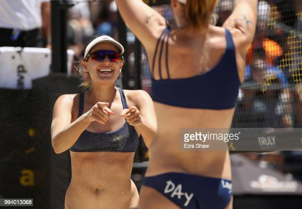 Betsi Flint and Emily Day celebrate winning a point during their semifinal match against Brittany Howard and Kelly Reeves of the AVP San Francisco...