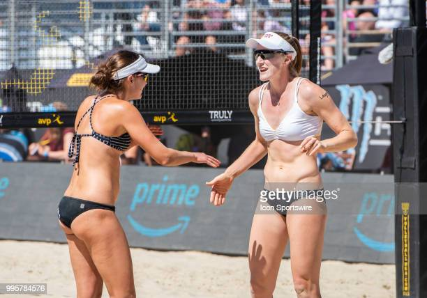 Betsi Flint and Emily Day congratulate each other on a successful volley in the women's Finals of the AVP Pro Beach Volleyball Tour on Sunday July 8...