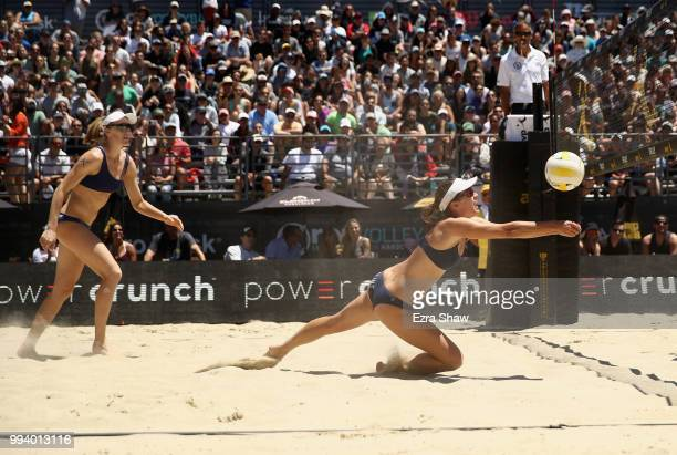 Betsi Flint dives for the ball as her partner Emily Day looks on during their semifinal match against Brittany Howard and Kelly Reeves of the AVP San...