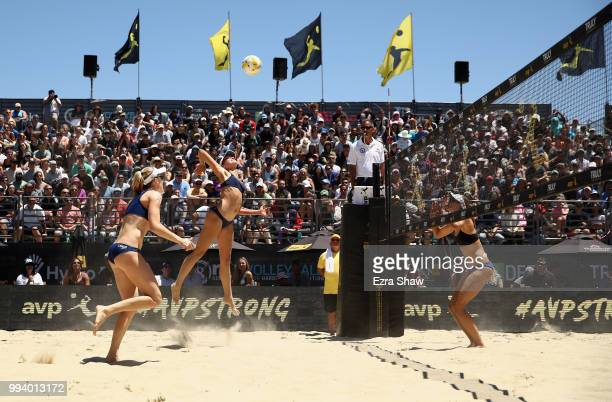 Betsi Flint goes up to spike the ball against as her partner Emily Day looks on during their semifinal match against Brittany Howard and Kelly Reeves...