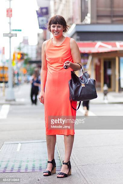 Betsy Carroll wears a Necessary Clothing dress vintage belt Payless shoes and a MOMA gift store necklace in June 2012 in Soho New York City