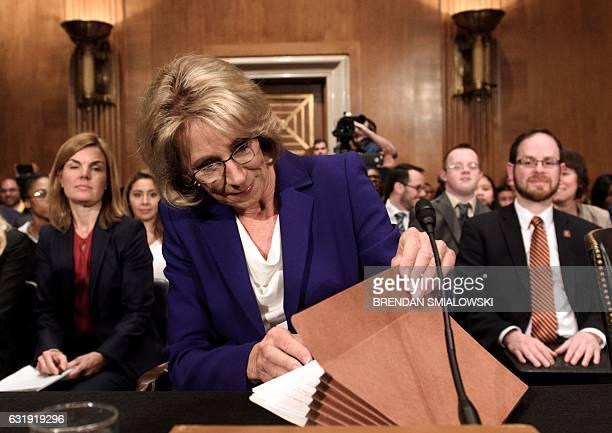 Betsy DeVos arrives for her Secretary of Education confirmation hearing in the Trump administration on Capitol Hill in Washington DC on January 17...