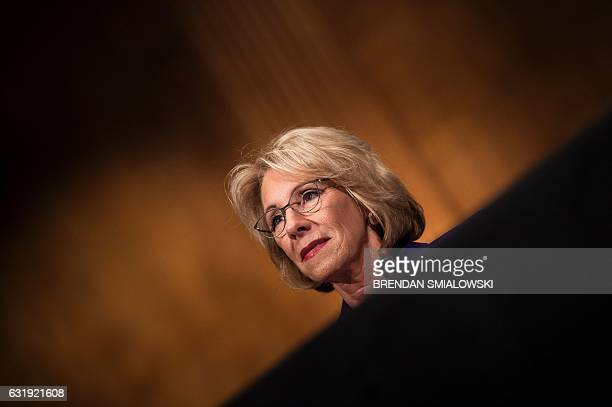 Betsy DeVos listens during her confirmation hearing for Secretary of Education before the Senate Health Education Labor and Pensions Committee on...