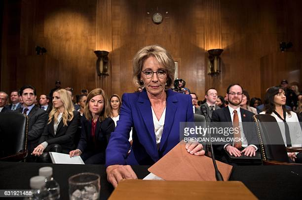 Betsy DeVos looks her papers over before her confirmation hearing for Secretary of Education before the Senate Health Education Labor and Pensions...
