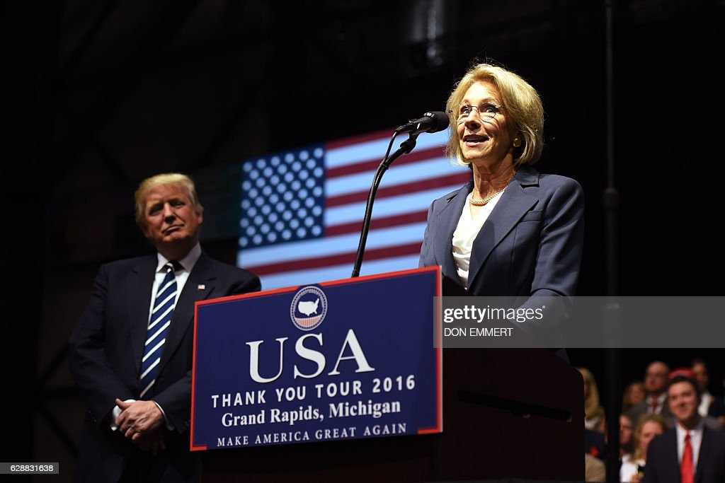 Betsy DeVos, picked by US President-elect Donald Trump for education secretary, speaks during the USA Thank You Tour December 9, 2016 in Grand Rapids, Michigan. / AFP / DON