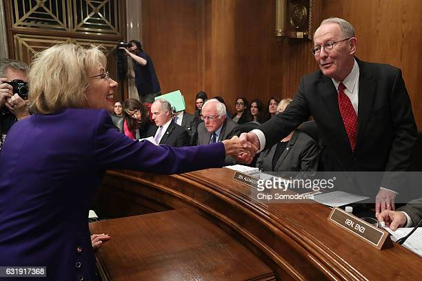 Betsy DeVos Presidentelect Donald Trump's pick to be the next Secretary of Education greets Senate Health Education Labor and Pensions Committee...