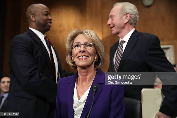 Betsy DeVos Presidentelect Donald Trump's pick to be the next Secretary of Education prepares to testify during her confirmation hearing before the...