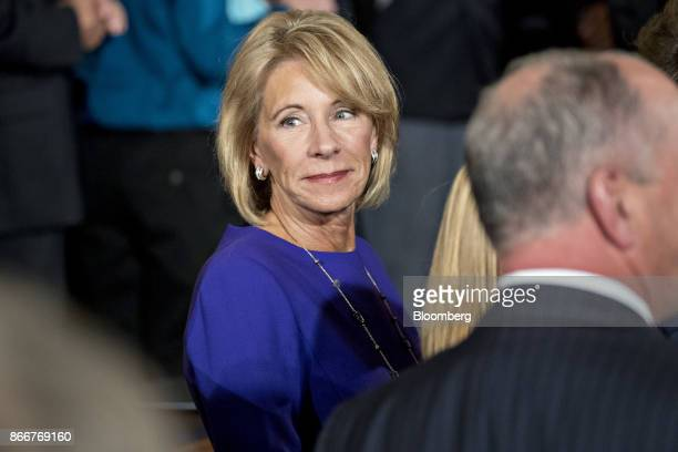 Betsy DeVos US secretary of education attends an event on combatting drug demand and the opioid crisis with US President Donald Trump not pictured in...