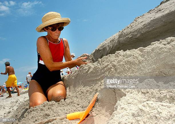 Betsy Fadem of Devon Pennsylvania works on her Finding Nemo in Ocean City sand sculpture during the 28th Annual Miss Crustacean Pageant and Hermit...
