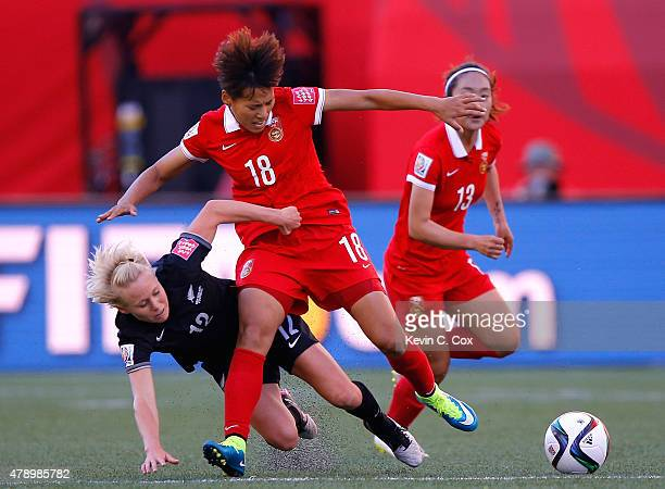 Betsy Hassett of New Zealand against Han Peng of China PR during the FIFA Women's World Cup Canada 2015 Group A match between China PR and New...
