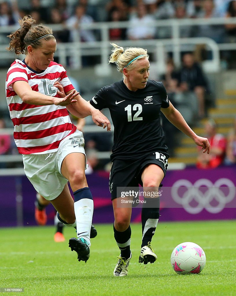 Betsy Hassett of New Zealand holds off Lauren Cheney of USA during the Women's Football Quarter Final match between United States and New Zealand, on Day 7 of the London 2012 Olympic Games at St James' Park on August 3, 2012 in Newcastle upon Tyne, England.