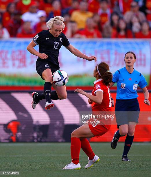 Betsy Hassett of New Zealand leaps high for the ball against Tang Jiali of China PR during the FIFA Women's World Cup Canada 2015 Group A match...
