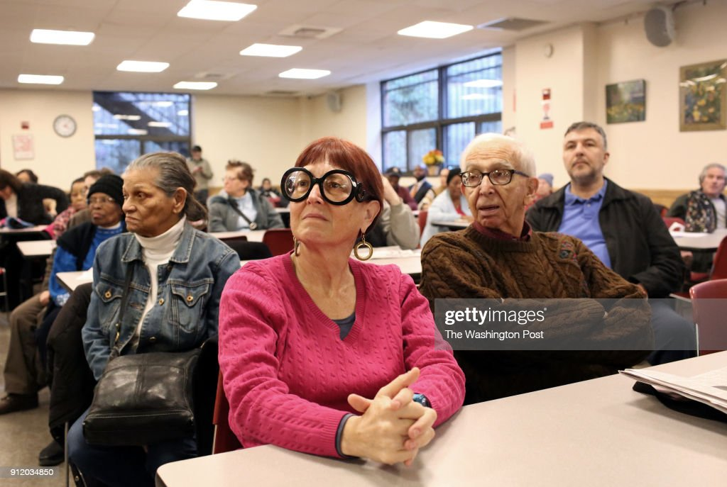 Betsy Malcolm, (center,) 62, from Manhattan, awaits Congressman Jerry Nadler to speak at a community forum at the Goddard Riverside Community Center in Manhattan, NY, on January 25, 2018.