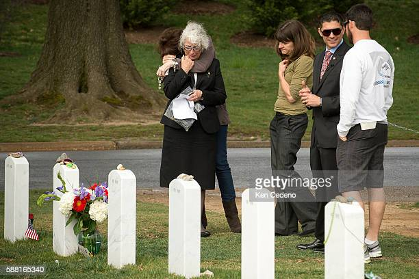 Betsy Reed Schultz 2nd right is hugged by Angelique Skoulas left of Washington DC a dear friend of Army Special Forces Capt Joseph Schultz March 14...