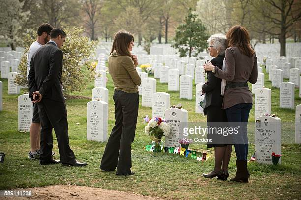 Betsy Reed Schultz 2nd right is hugged by Angelique Skoulas right of Washington DC a dear friend of Army Special Forces Capt Joseph Schultz March 14...