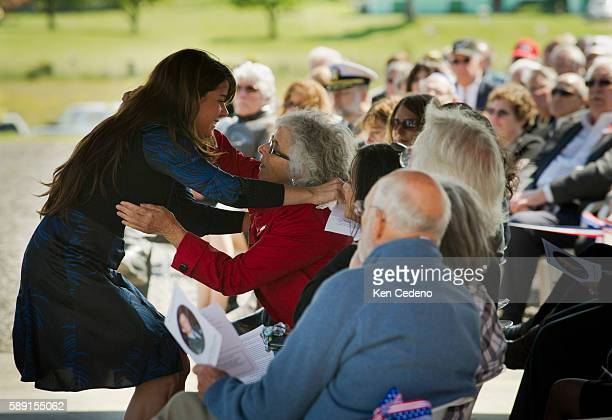 Betsy ReedSchultz is hugged by a friend during memorial service for her son Army Special Forces Capt Joseph Schultz in Port Angeles WA June 11 2011...