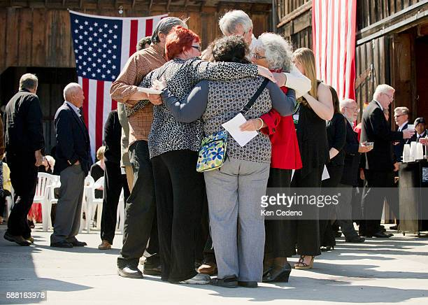 Betsy ReedSchultz is hugged by a friends following memorial service for her son Army Special Forces Capt Joseph Schultz in Port Angeles WA June 11...