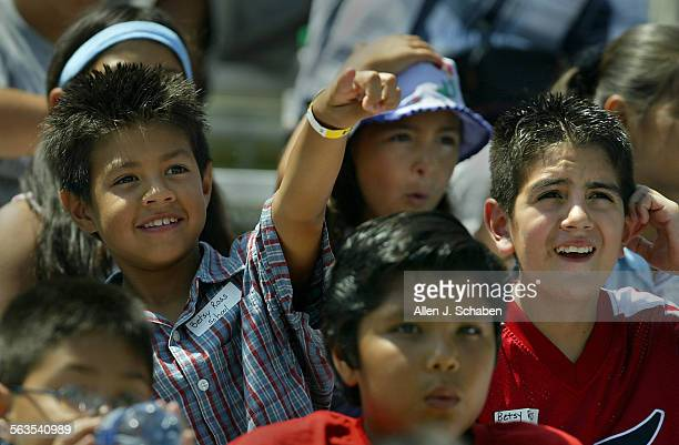 Betsy Ross Elementary Anaheim fifth–grade students from lower left Jassiel Velasquez Jacob Mendoza Edgar Munguia Rikki Ponce and Josue Guijarro right...