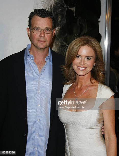 Betsy Russell and Mark Burg attend the premiere of Saw V at Mann's Chinese Six on October 21 2008 in Hollywood California