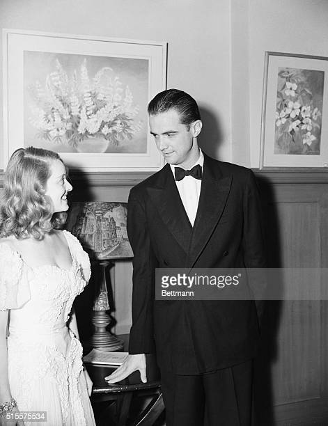 Bette Davis and Howard Hughes attending a charity dinner and dance, at Beverly Hills Hotel in Los Angeles, to help provide shelters for dogs.